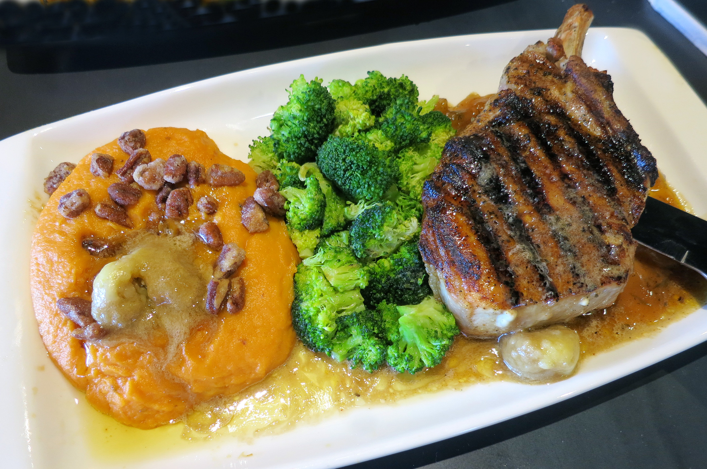 Pork Chop with Honey Apple Chutney: Cajun-seasoned hand-cut pork chop ...